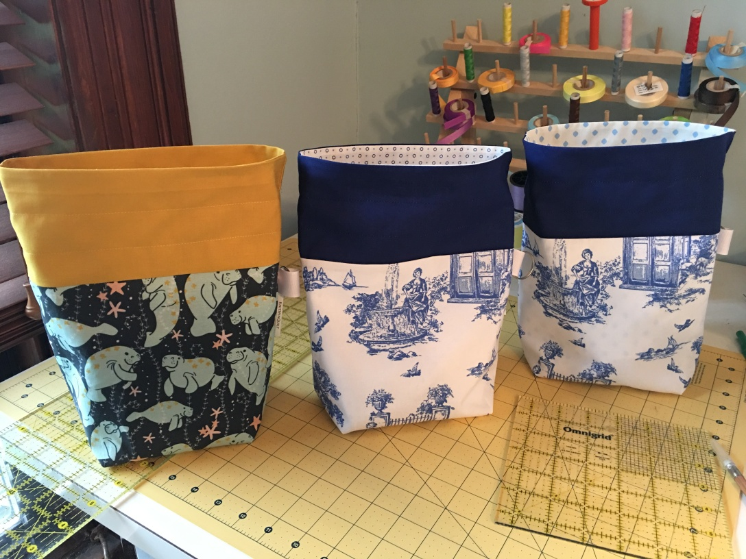 Three drawstring bags