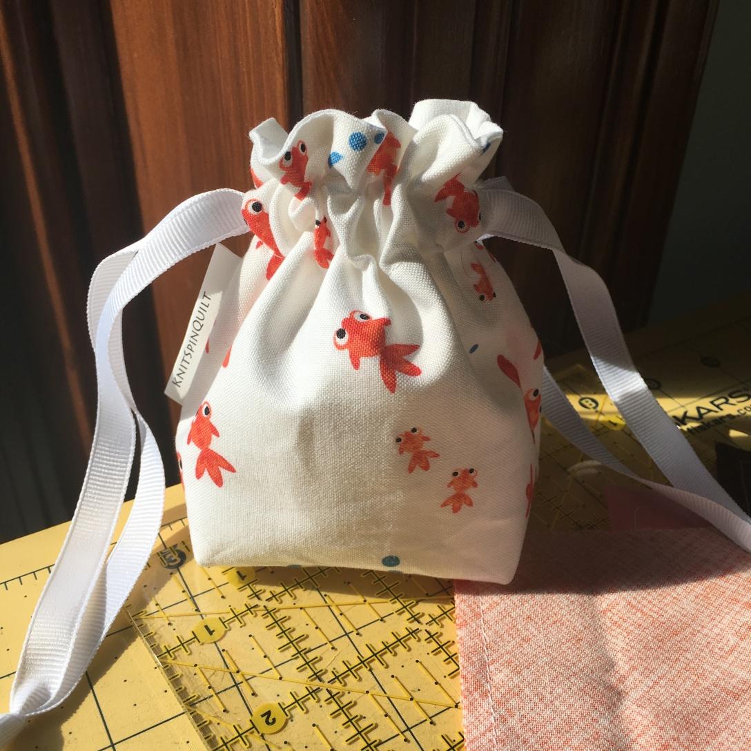 Goldfish dice bag
